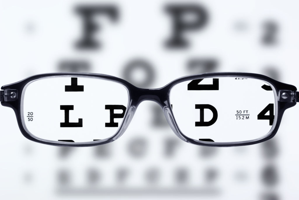 Eye glasses and eye chart